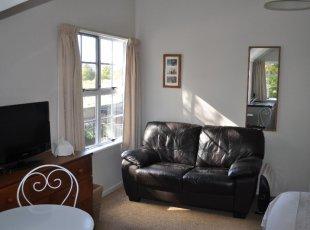Studio room with sofa